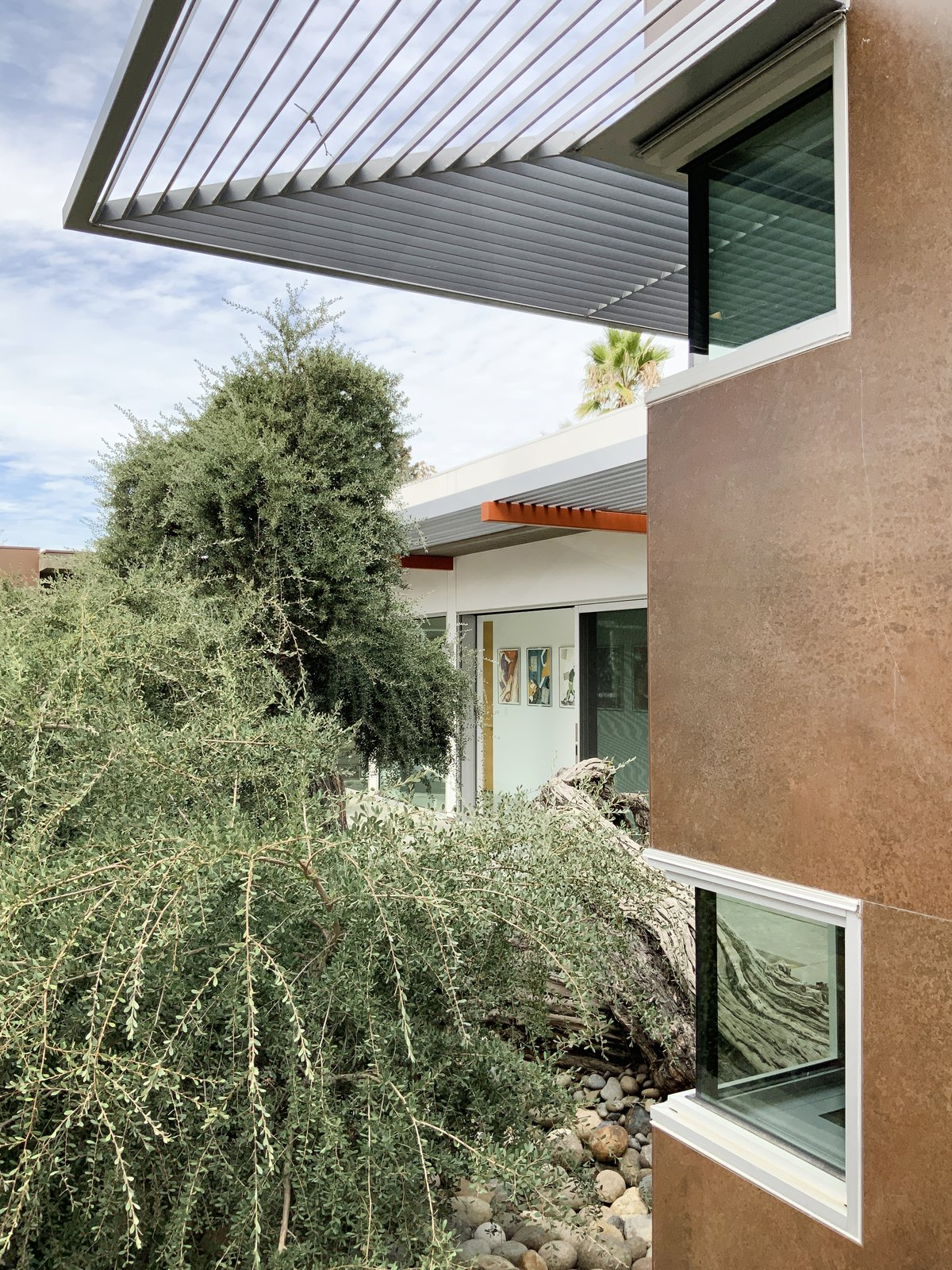 Exterior Steel sunshades and corten-inspired wall tile.  Oak Street by Rossington Architecture