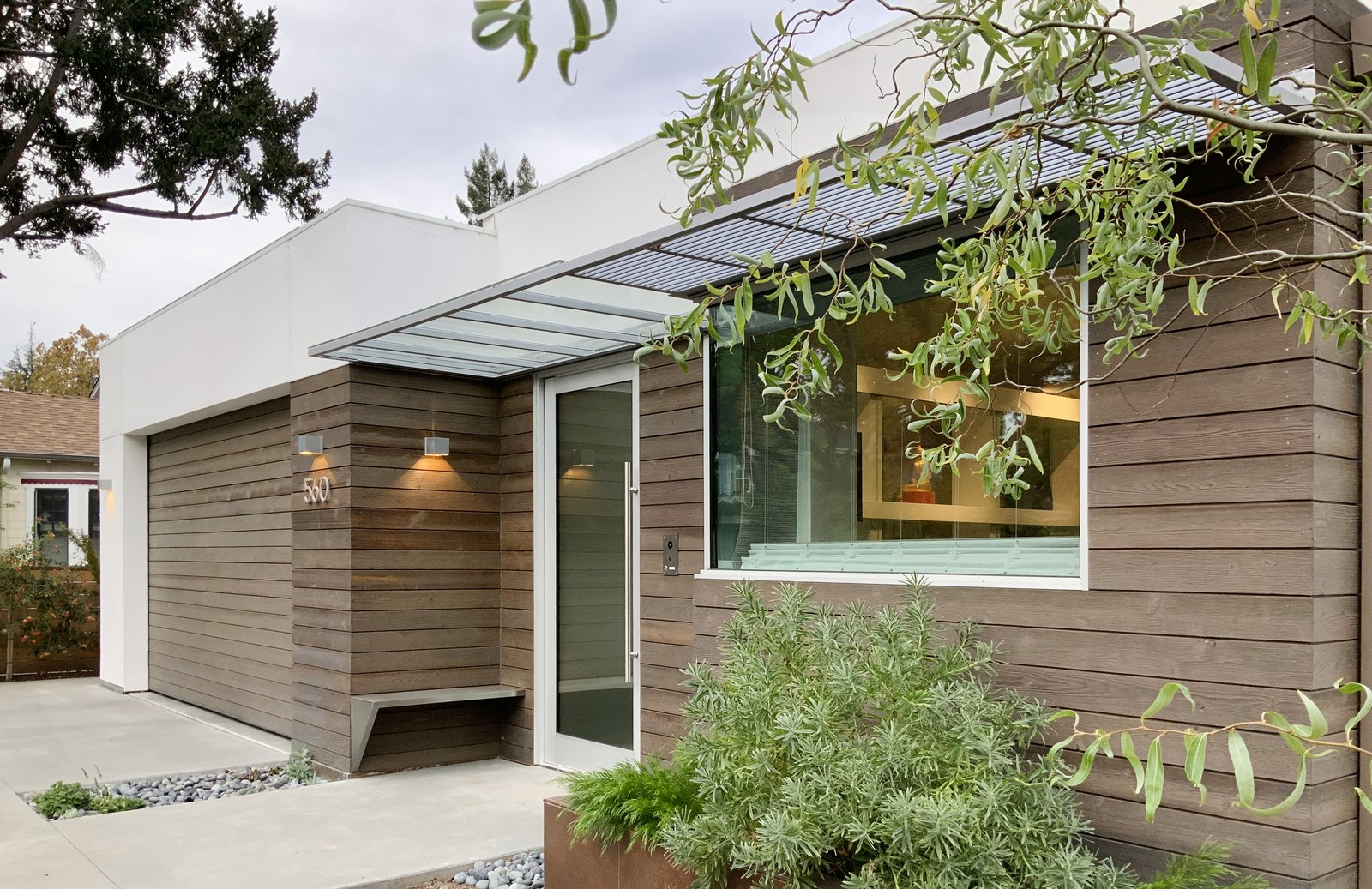 Exterior, Wood Siding Material, House Building Type, Flat RoofLine, and Stucco Siding Material A simple palette of white stucco and cedar with sunshade accents.  Oak Street by Rossington Architecture