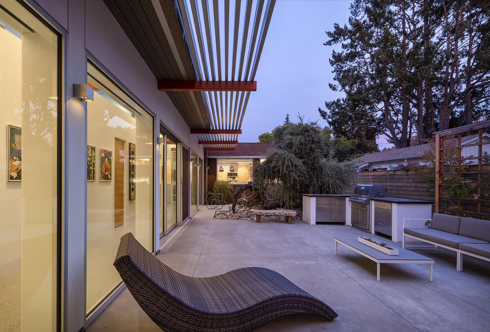 Exterior courtyard at dusk  Oak Street by Rossington Architecture