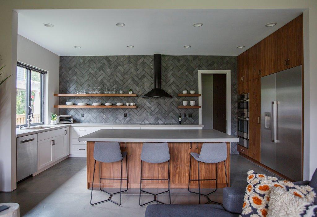 Kitchen, Engineered Quartz Counter, White Cabinet, Concrete Floor, Ceramic Tile Backsplashe, Ceiling Lighting, Wood Cabinet, Refrigerator, Wall Oven, Cooktops, Range Hood, and Undermount Sink Kitchen  HoF