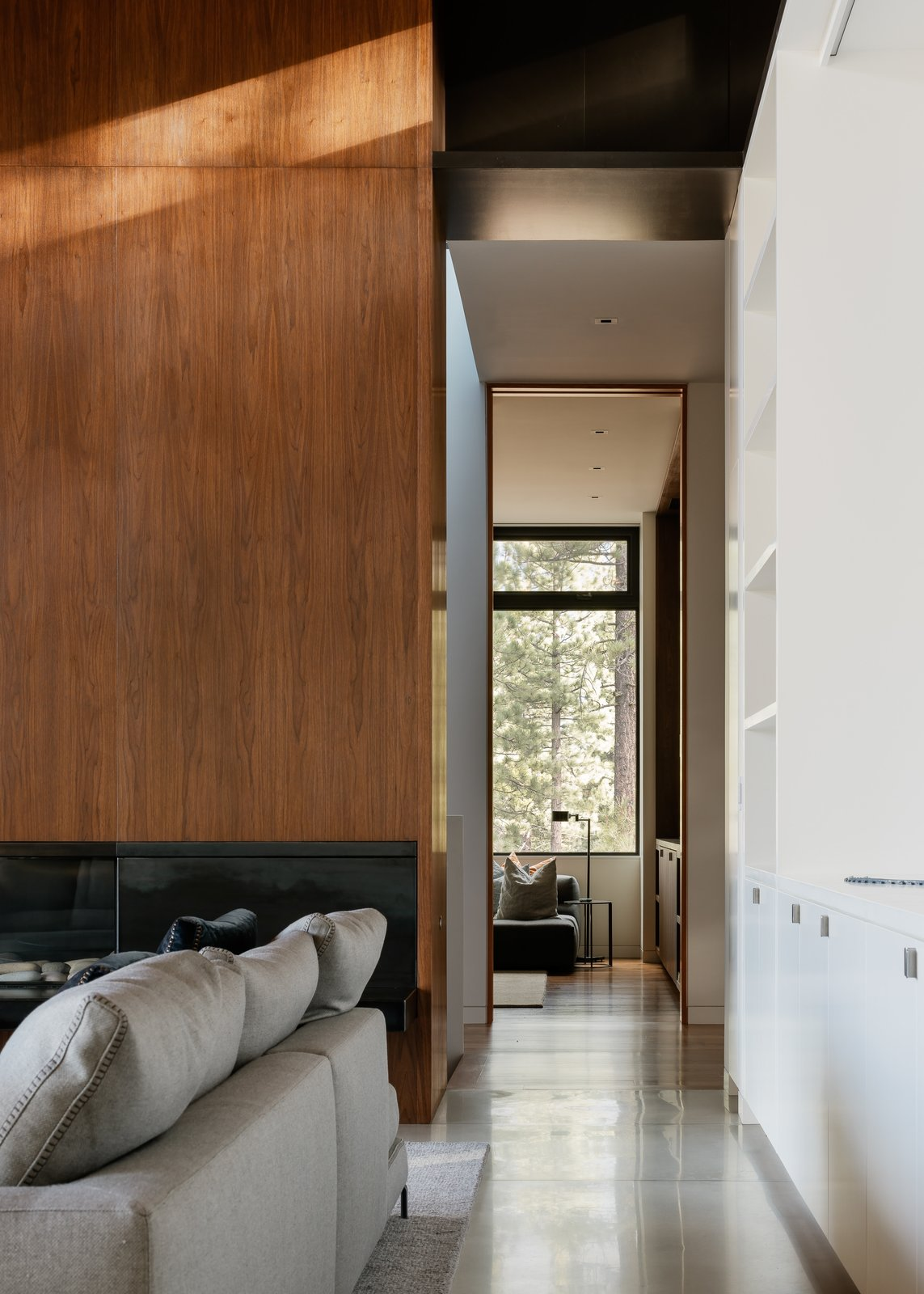 Hallway and Concrete Floor Living Room Hallway  Martis Camp Residence 1 by John Maniscalco Architecture
