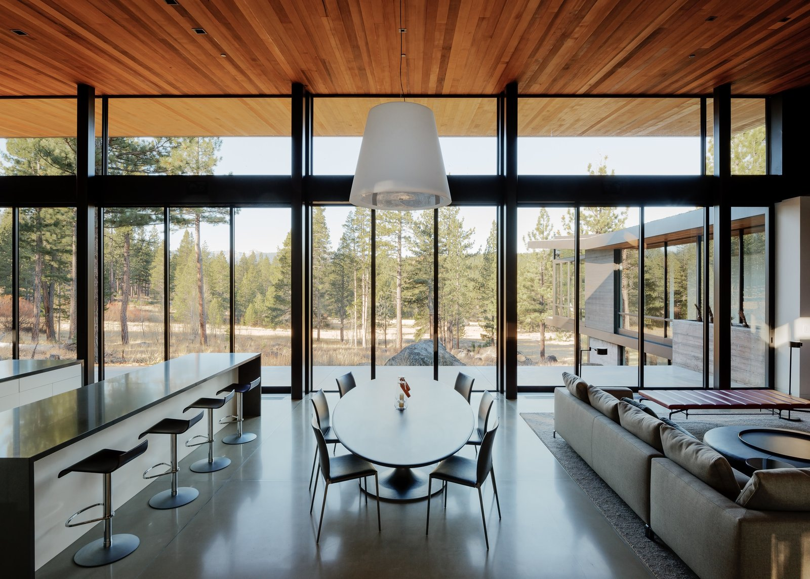 Dining Room, Pendant Lighting, Concrete Floor, Table, Chair, and Stools Dining Room  Martis Camp Residence 1 by John Maniscalco Architecture