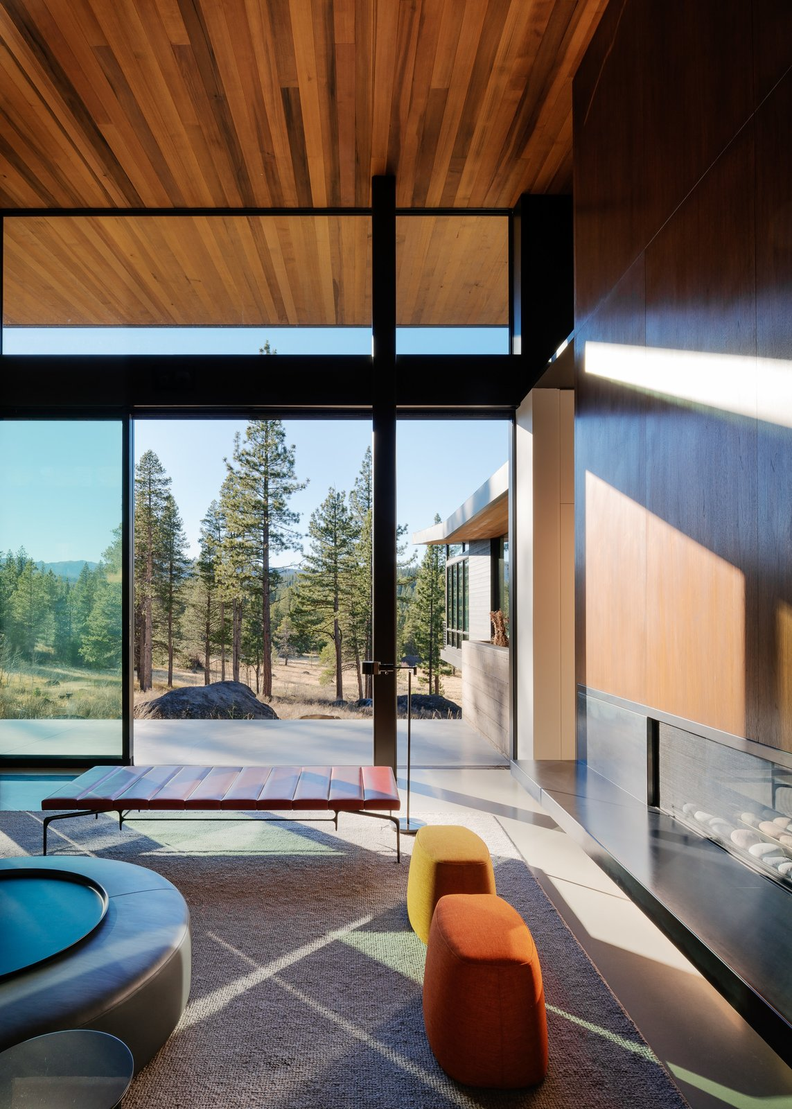 Living Room, Ottomans, Ribbon Fireplace, Bench, Concrete Floor, and Gas Burning Fireplace Living Room  Martis Camp Residence 1 by John Maniscalco Architecture