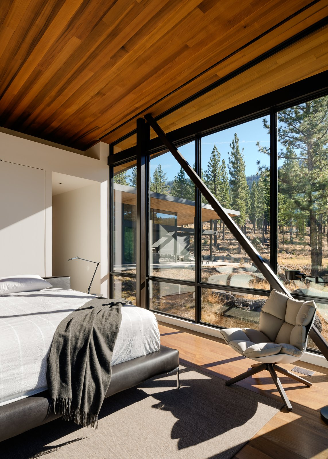 Bedroom, Bed, Chair, and Light Hardwood Floor Master Bedroom  Martis Camp Residence 1 by John Maniscalco Architecture