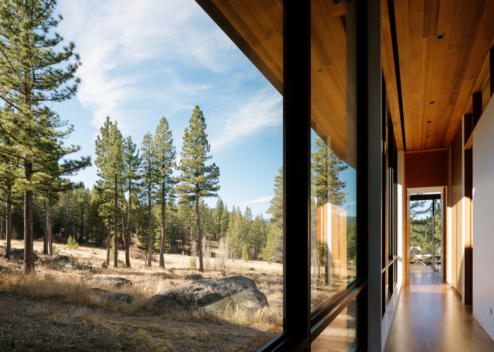 Hallway and Concrete Floor Master Bedroom Hallway  Martis Camp Residence 1 by John Maniscalco Architecture