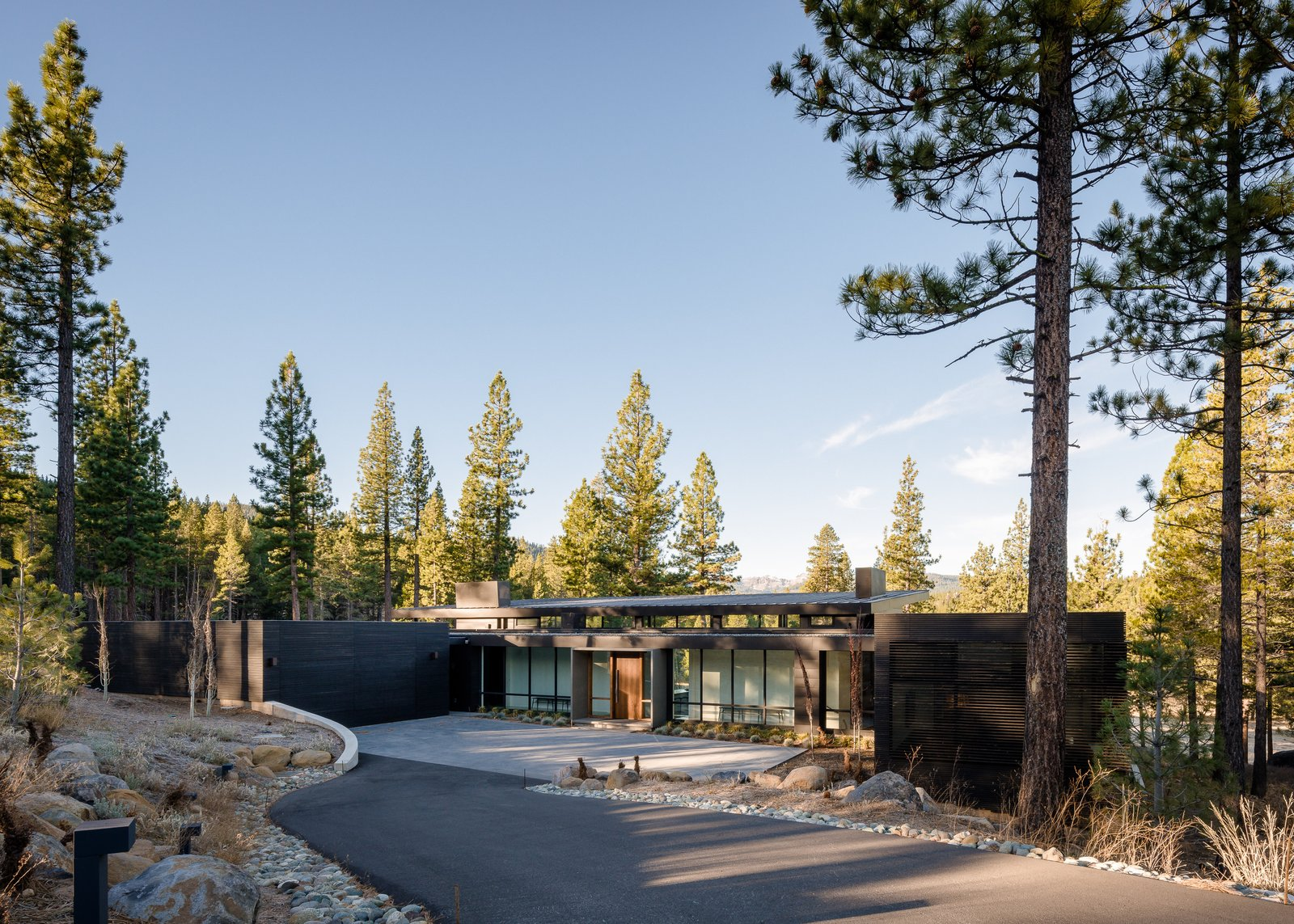 Exterior, House Building Type, Metal Siding Material, Flat RoofLine, and Shed RoofLine Entry Driveway Approach   Martis Camp Residence 1 by John Maniscalco Architecture