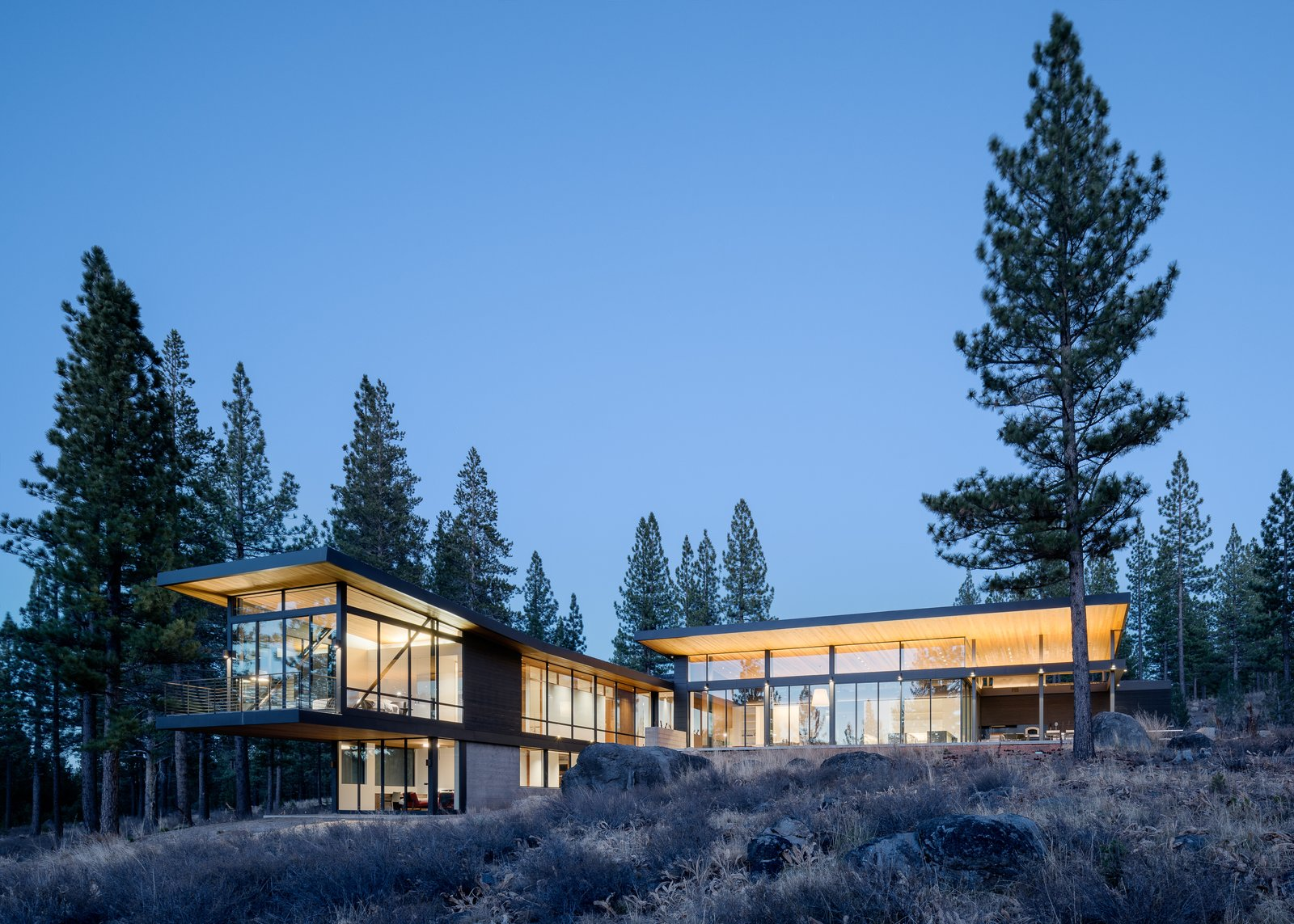 Outdoor, Back Yard, Boulders, Trees, Shrubs, Flowers, and Large Patio, Porch, Deck Rear Facade  Martis Camp Residence 1 by John Maniscalco Architecture
