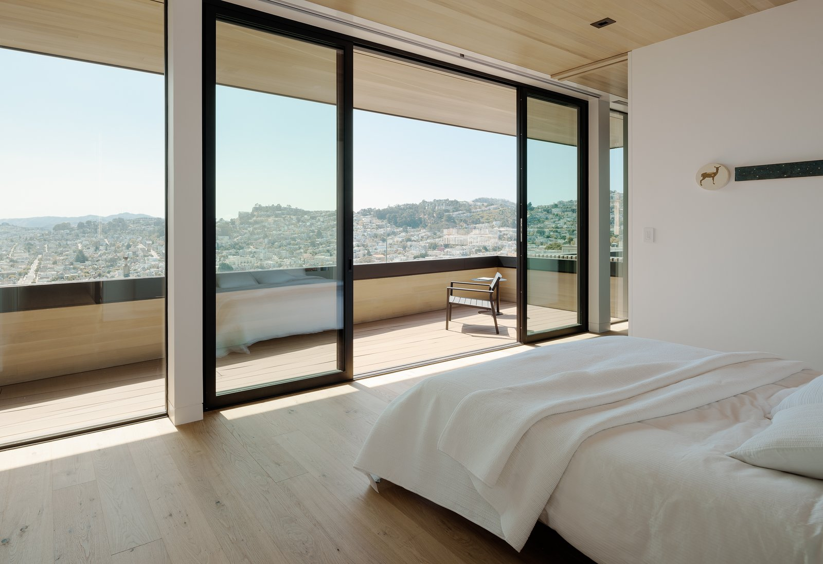 Bedroom, Chair, Light Hardwood Floor, Bed, and Recessed Lighting Master Bedroom to View  Dolores Heights Residence I by John Maniscalco Architecture