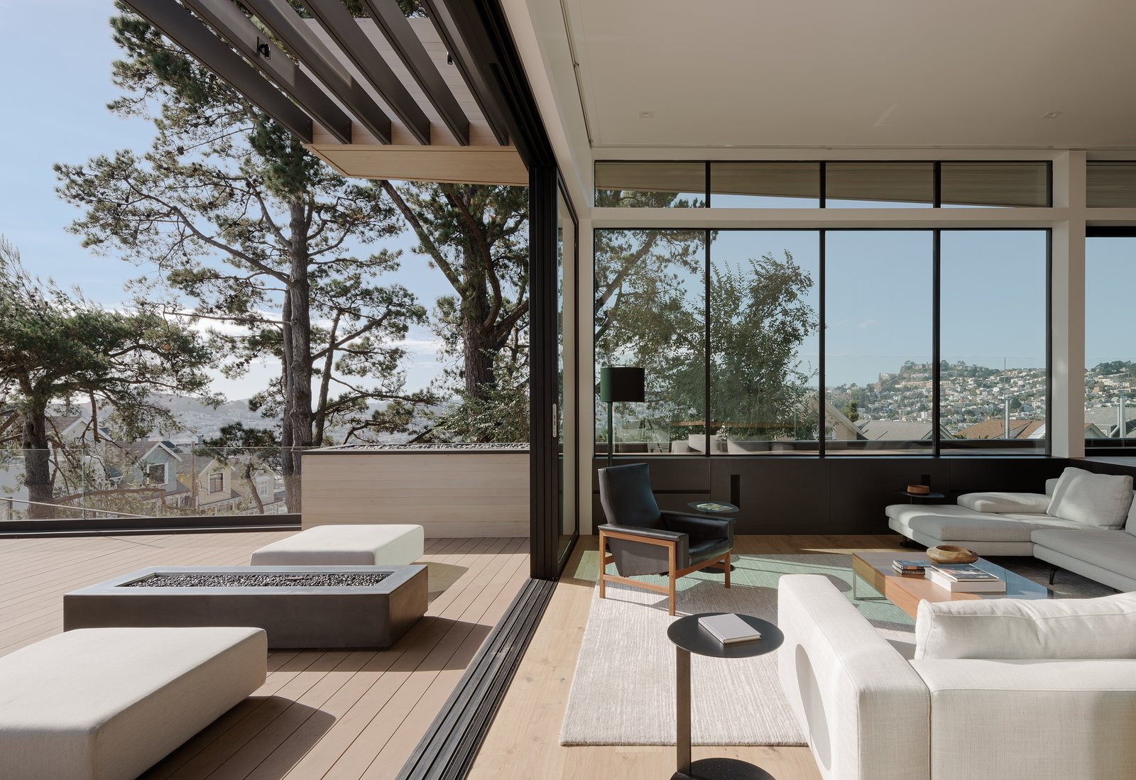 Living Room, Sectional, Sofa, Coffee Tables, Recessed Lighting, End Tables, Bench, Chair, and Light Hardwood Floor Blurred Line Between Living Room and Exterior  Dolores Heights Residence I by John Maniscalco Architecture