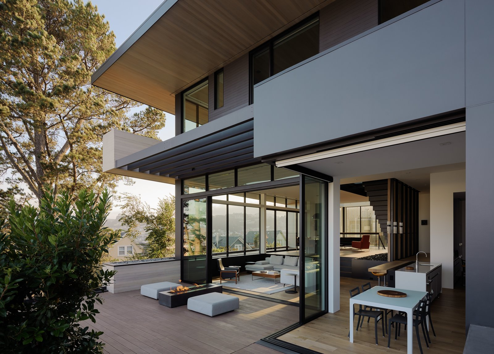 Outdoor, Concrete Patio, Porch, Deck, Shrubs, Hardscapes, Trees, Metal Patio, Porch, Deck, Wood Patio, Porch, Deck, Walkways, Side Yard, and Large Patio, Porch, Deck Exterior into Kitchen and Living Room   Dolores Heights Residence I by John Maniscalco Architecture