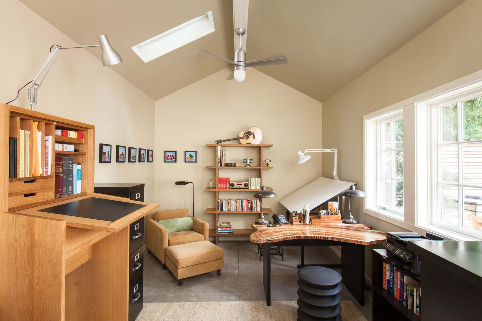 Office, Study Room Type, Desk, Bookcase, Shelves, and Concrete Floor Mid-way through construction, the owner decided to convert the garage into an office, as he liked it too much to give it over to parking. For more info: https://www.howellsarc.com/projects/michael-b/  Michael B by Howells Architecture + Design