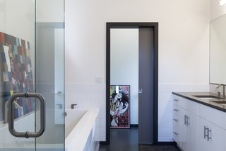 IKEA cabinetry and marmoleum flooring helped keep bathroom costs down.