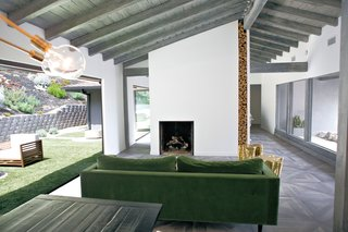 The original rear wall of the house had one small sliding glass door, and several fixed windows that had been broken and water damaged.   Two NanaWall bifold glass walls replaced the windows, opening the entire back wall to indoor-outdoor living.