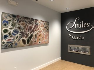 Artist Deborah Argyropoulos painted this unique abstract to act as the showcase work for the office of cosmetic dentist Arturo Garcia.