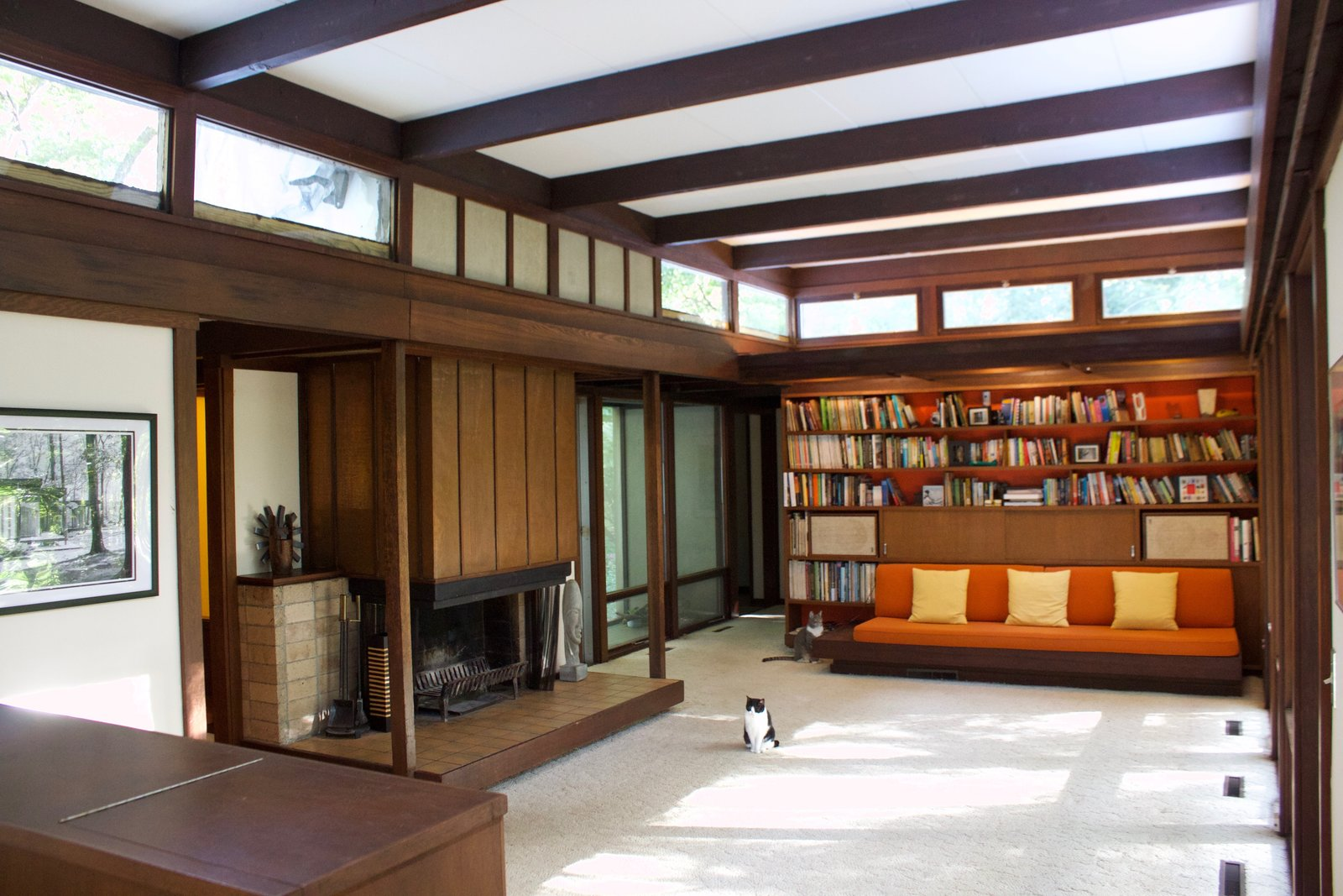 Living Room, Chair, Bench, Sofa, Bookcase, Coffee Tables, Recessed Lighting, Carpet Floor, and Standard Layout Fireplace Living room  Kalamazoo Post and Beam Restoration by Trystcraft