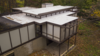 Modern home with Exterior, House Building Type, Mid-Century Building Type, Flat RoofLine, and Concrete Siding Material. New flat roof Photo 12 of Kalamazoo Post and Beam Restoration