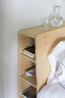 Headboard shelves for books and power strip; antique carafe