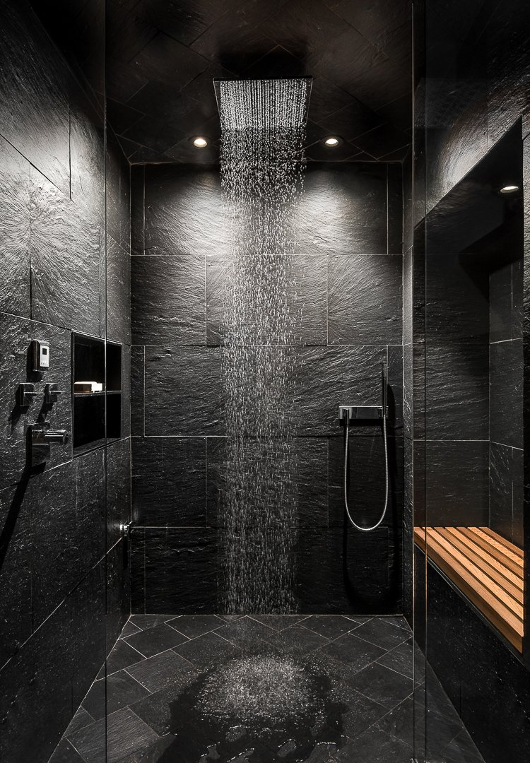 Bath Room, Ceiling Lighting, Enclosed Shower, Slate Floor, and Stone Tile Wall Rain shower  House in the Woods by Kim Smith