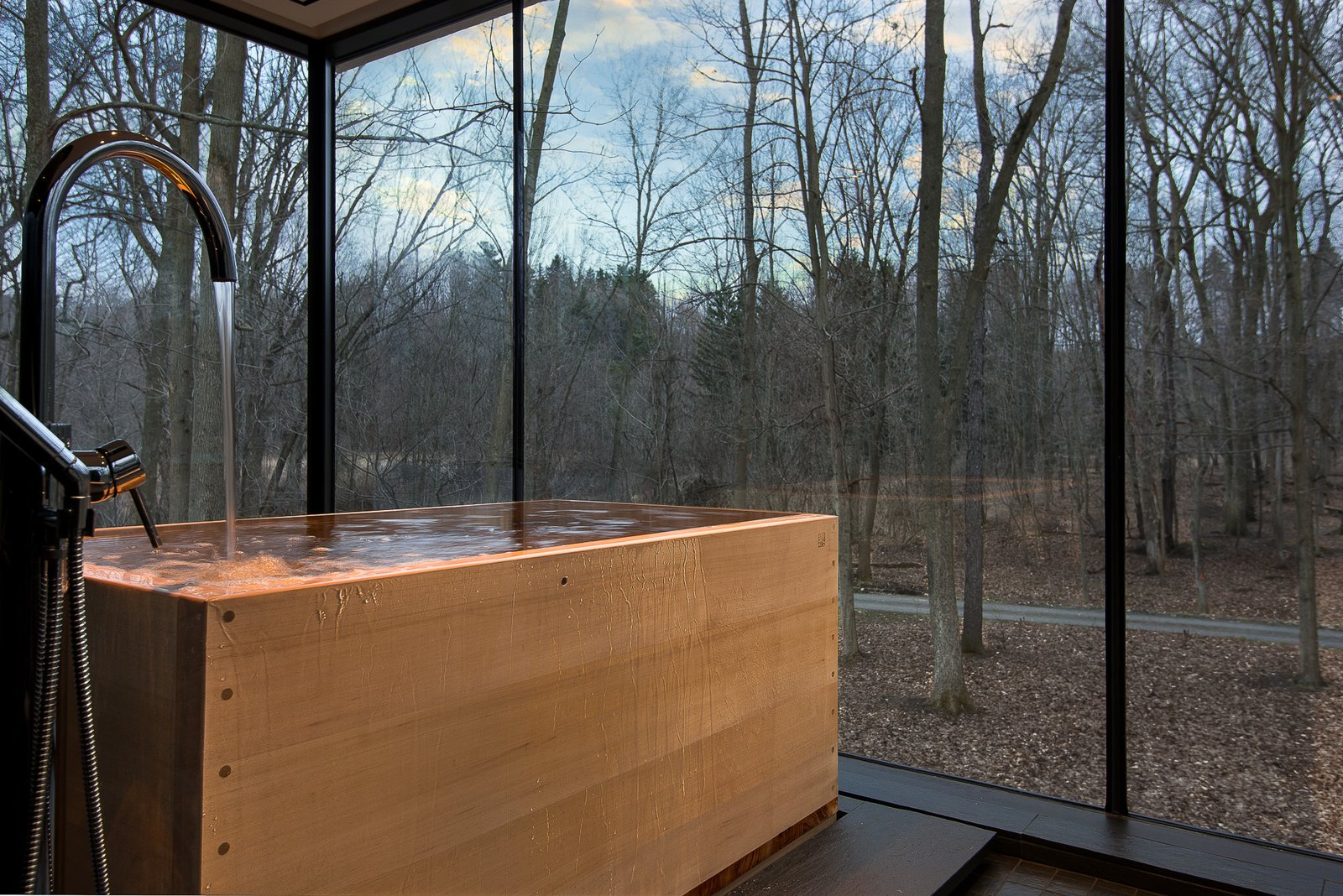 Bath Room, Slate Floor, Soaking Tub, and Freestanding Tub Hinoki tub with floor drain  House in the Woods by Kim Smith