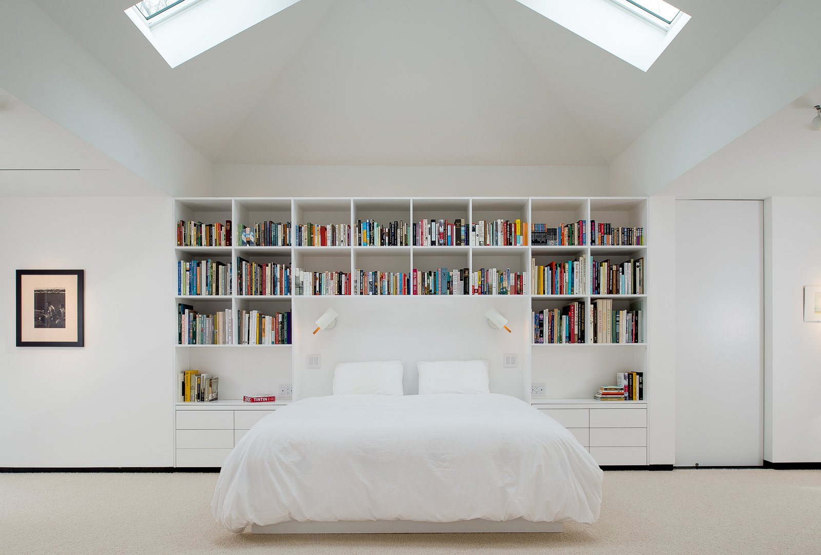 Bedroom, Bed, Storage, Bookcase, Shelves, Night Stands, Track, Pendant, and Carpet Master bedroom daytime  Best Bedroom Bookcase Carpet Track Photos from House in the Woods
