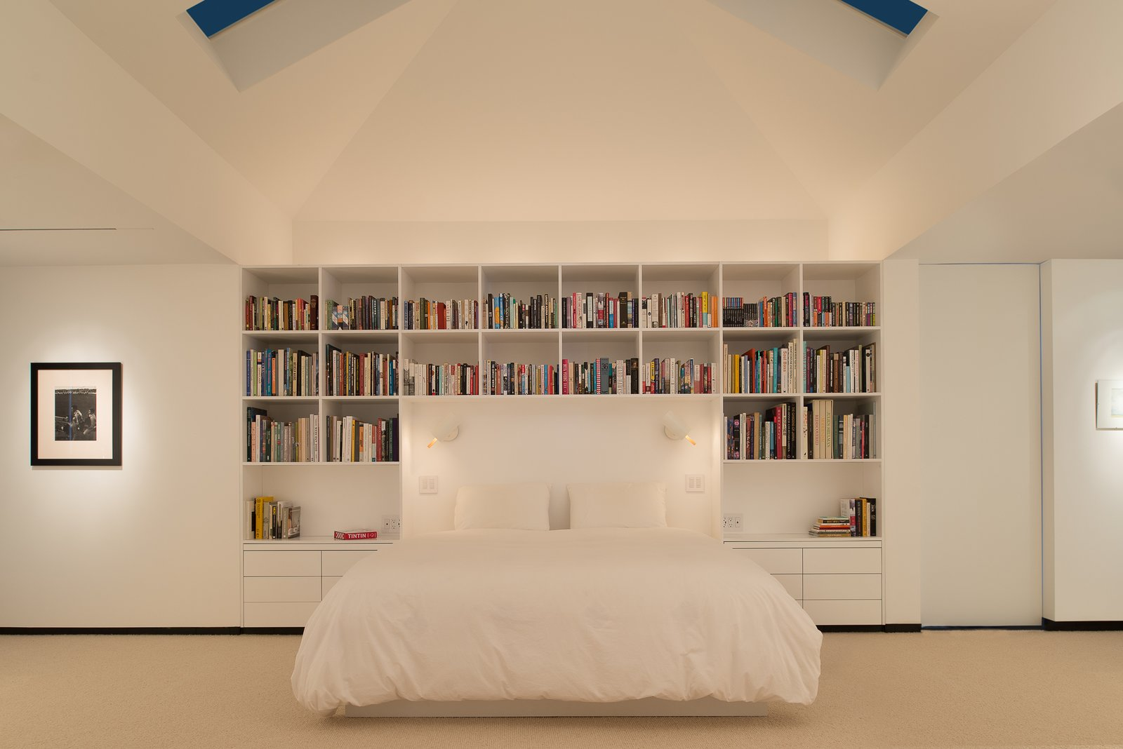 Bedroom, Bed, Bookcase, Shelves, Storage, Night Stands, Track, Wall, and Carpet Master bedroom night  Best Bedroom Shelves Bookcase Night Stands Photos from House in the Woods