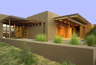 The contemporary home has over 766 square feet of portal space offering exceptional indoor outdoor living in Santa Fe