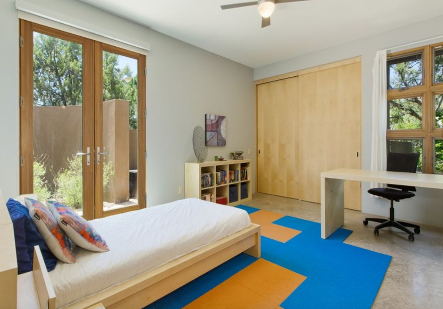 Kids, Bed, Bedroom, Bookcase, Chair, Boy, Desk, Concrete, and Teen Each guest room has its own courtyard and views of the Jemez Mountains  Kids Bookcase Teen Photos from Santa Fe Contemporary