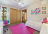 Modern home with Kids Room, Bed, Chair, Concrete Floor, Rockers, Pre-Teen Age, and Girl Gender. The generous sized guest rooms share a bathroom and offer impressive views of the High Desert. Photo 2 of Santa Fe Contemporary