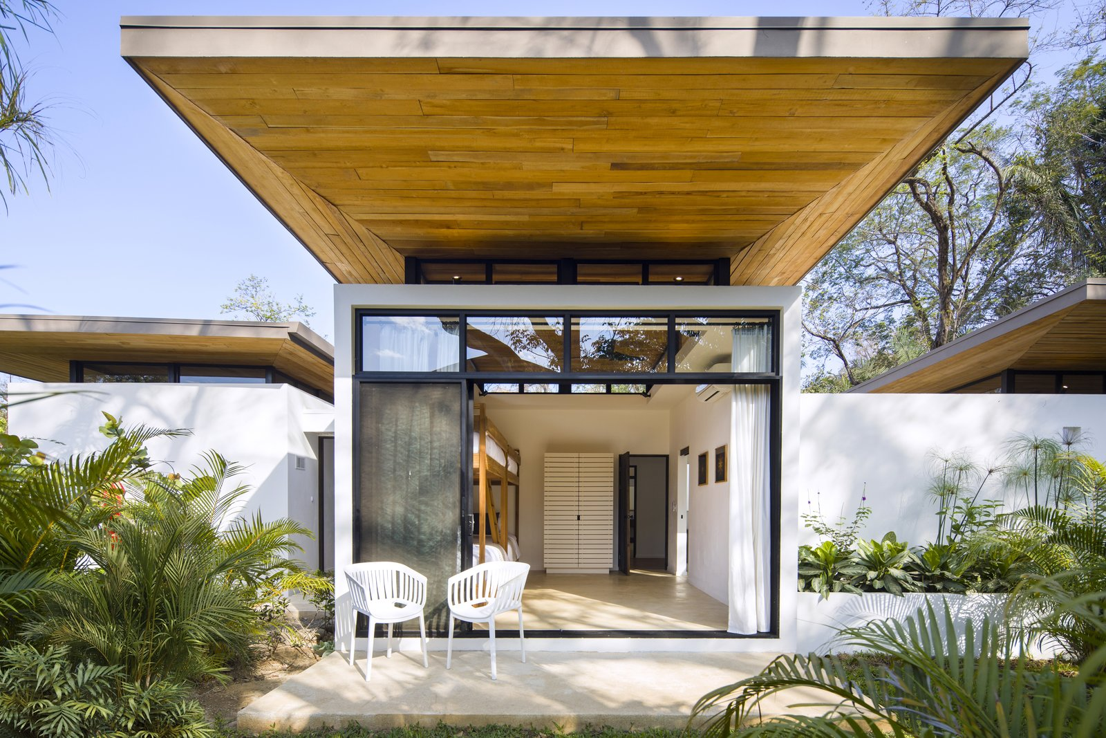 Outdoor, Small Patio, Porch, Deck, Gardens, and Shrubs The underside of the overhanging roof represents the area's local craftsmanship.  Nalu Nosara from Decompress at This Boutique Hotel and Yoga Retreat in the Costa Rican Jungle