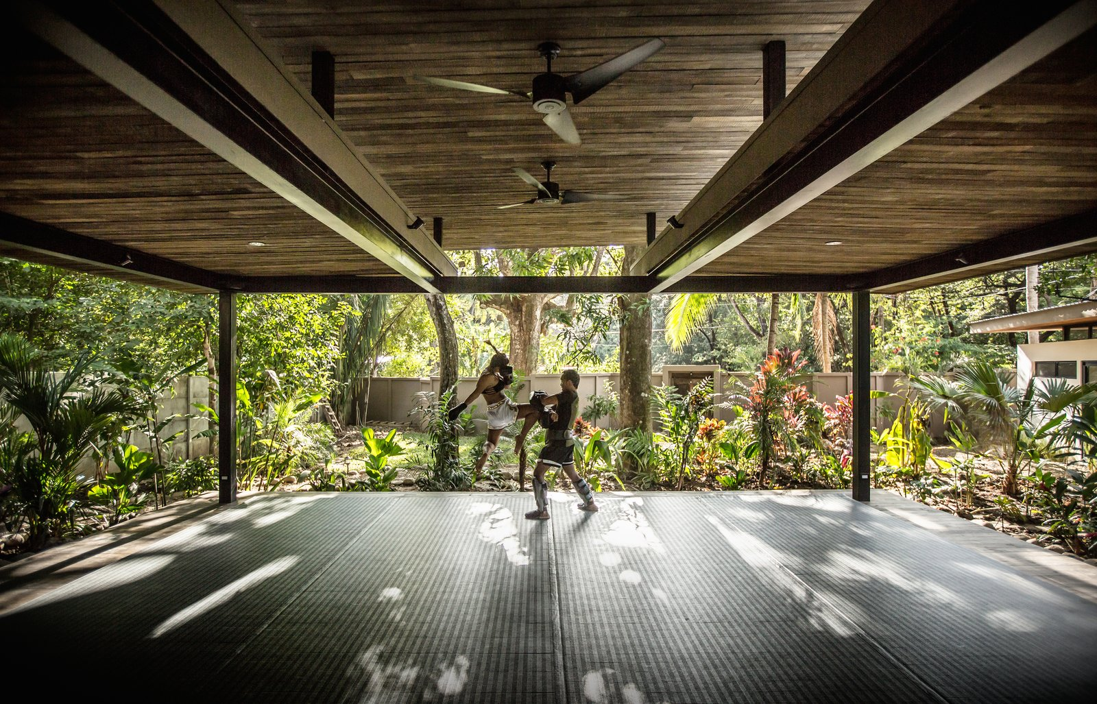 Shed & Studio The yoga studio is surrounded on all sides by the jungle.  Light, shadows, and wind pass through the open structure.  Photo 10 of 11 in Decompress at This Boutique Hotel and Yoga Retreat in the Costa Rican Jungle