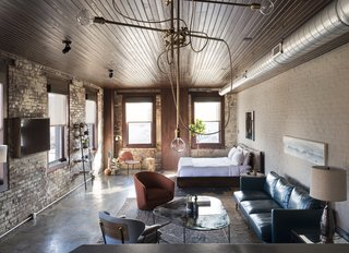 Room 1, located on the 2nd floor,  blends industrial detailing with exposed brick walls, polished concrete floors, rich textile finishes, and a custom walnut bed.