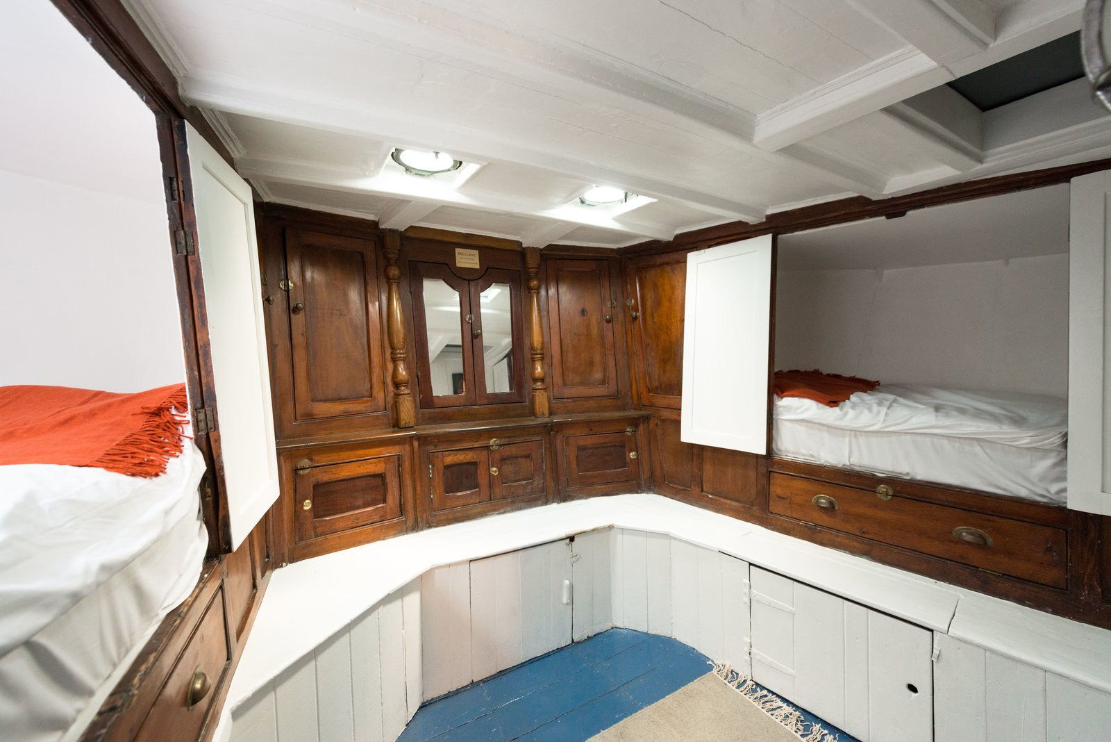 Bedroom, Storage, Ceiling Lighting, Bunks, and Rug Floor The bunk room provides built in sleeping quarters within the original woodwork.  Photo 6 of 9 in Londoners Can Live in This Scandinavian-Inspired, Converted Barge For $424K