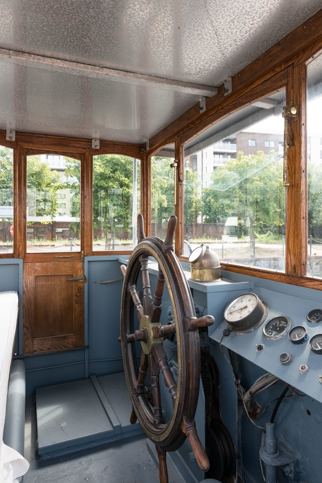 The Wheelhouse has been fully restored and provides 360 views through the glazing surrounds.  Photo 8 of 9 in Londoners Can Live in This Scandinavian-Inspired, Converted Barge For $424K