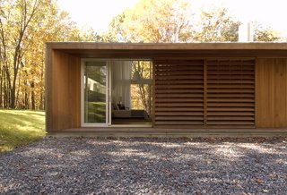 Wooden screens provide privacy to the master bedroom from the entrance facade.