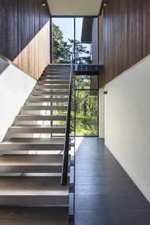 Open stair treads, composed of rift awn white oak with a custom stain, allow light to pass through.