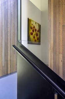 A custom steel and glass guardrail is built from careful detailing and restraint.