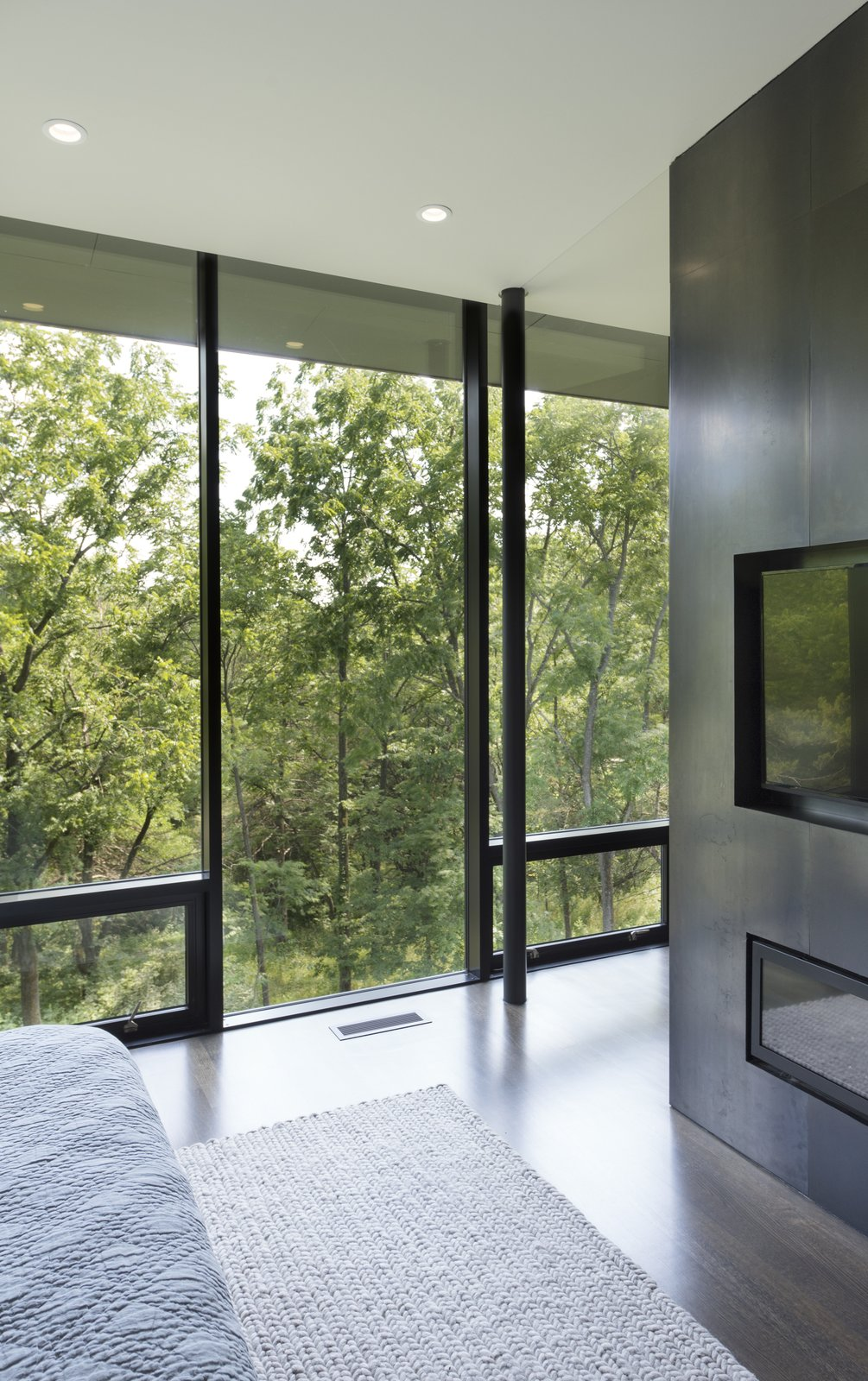 Windows, Picture Window Type, and Metal The master suite is filled with plentiful views, while taking advantage of the forest of cedars to provide complete privacy year round.  Photo 8 of 10 in An Incredible Forest Home Leaps Over a Ravine
