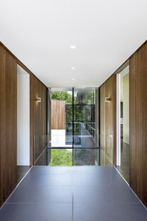 Large format Fiandre floor tiles fill the entry sequence and align with the building module.