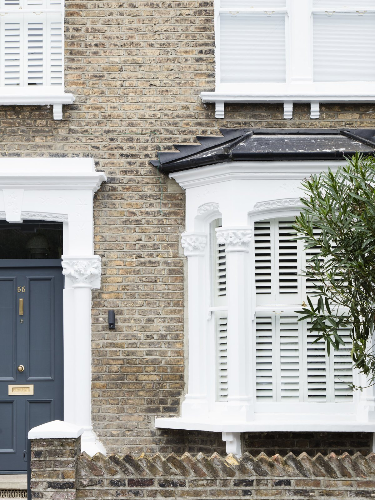 The renovated home respects the original period of the home, maintaining some of the original character.  From the front elevation, the contemporary refurbishments are concealed. Tagged: Exterior, Brick Siding Material, and House.  Photo 1 of 11 in A Sleek Renovation in London Ushers Light Into a Family Home