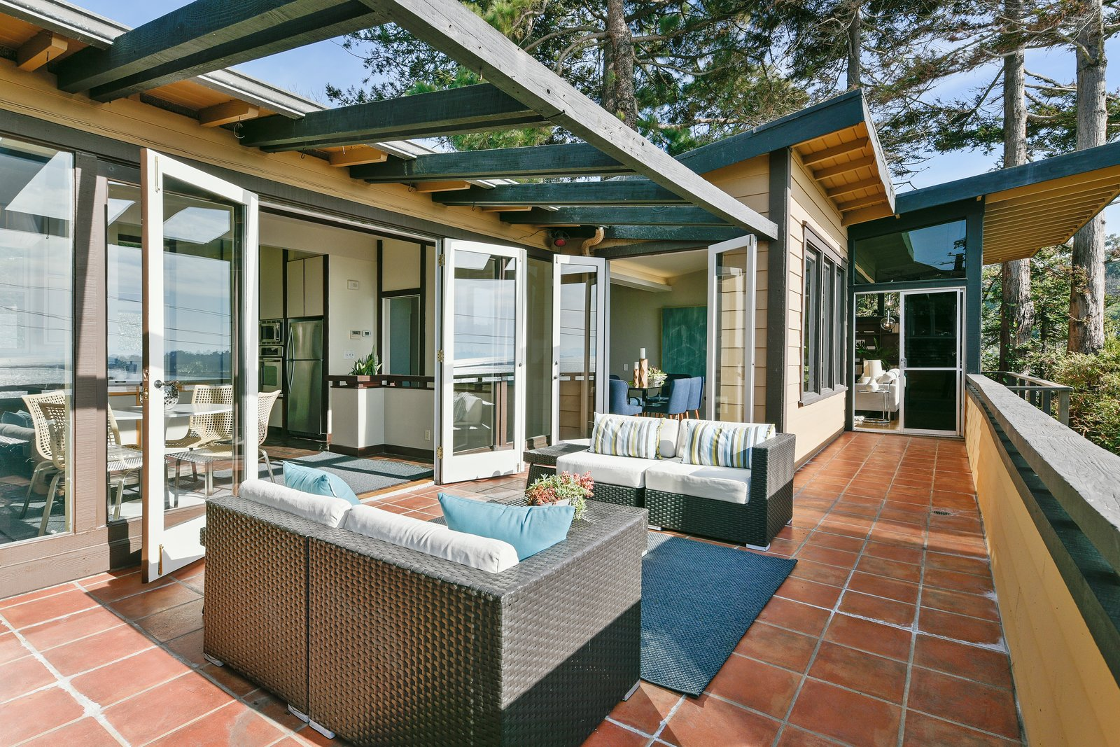 Outdoor, Large Patio, Porch, Deck, Trees, and Pavers Patio, Porch, Deck Exterior terraces wrap public living spaces.  A wooden pergola shades the exterior sitting space.  Photo 12 of 14 in A Bay Area Jewel With Golden Gate Views Wants $1.55M