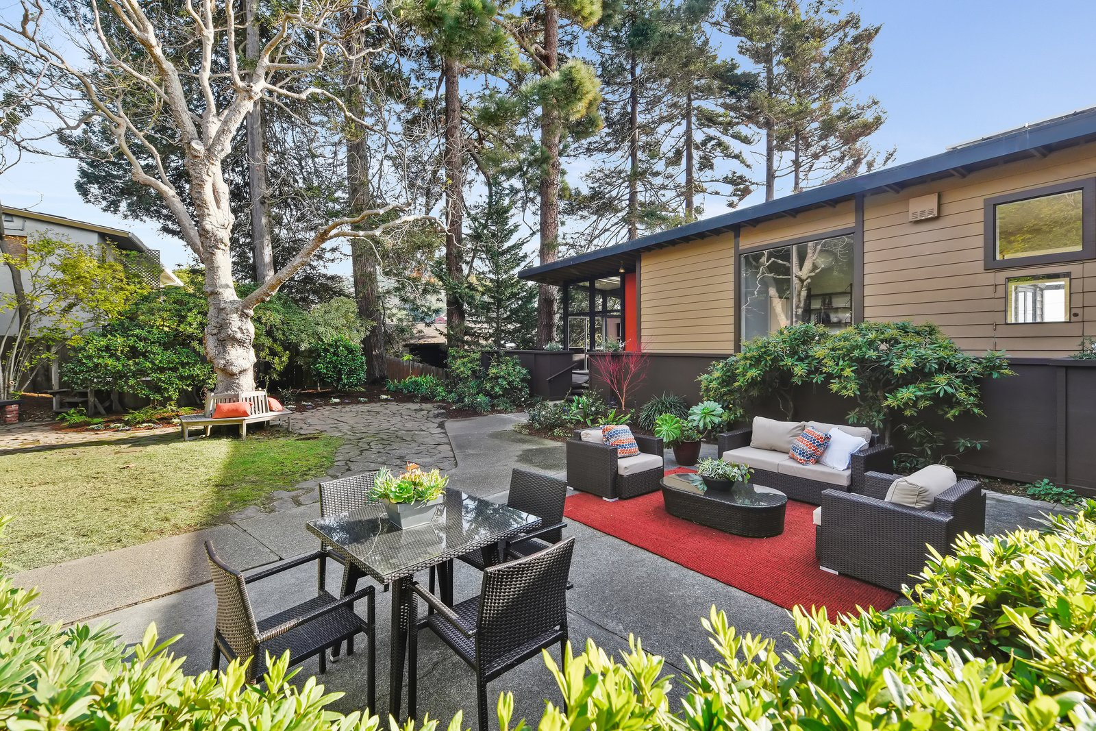 Outdoor, Trees, Walkways, Concrete Patio, Porch, Deck, and Back Yard Outdoor entertainment spaces are aplenty on the homes extensive grounds.  Photo 13 of 14 in A Bay Area Jewel With Golden Gate Views Wants $1.55M