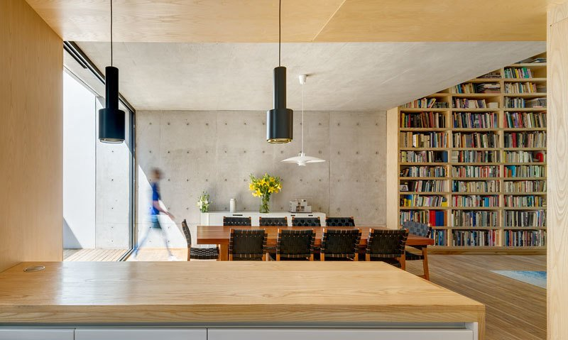 Kitchen, Pendant Lighting, Light Hardwood Floor, and Wood Counter Simple Alvar Aalto pendants hang below the wooden ceiling in the kitchen.  Photo 7 of 10 in A Sculptural Wooden Staircase Steals the Show in This Mexico City Abode