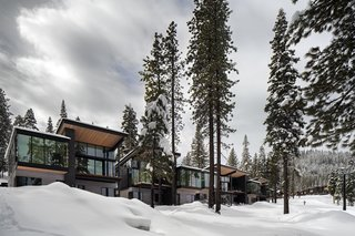 Western Red Cedar, stained black, gray, and natural, wrap the facades of the Residences.  Roof canopies reach outwards to engage with the homes' setting.  Windows by Sierra Pacific provide incredible views of the surroundings.