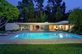 At nighttime, the house glows as a mid-century modern icon.