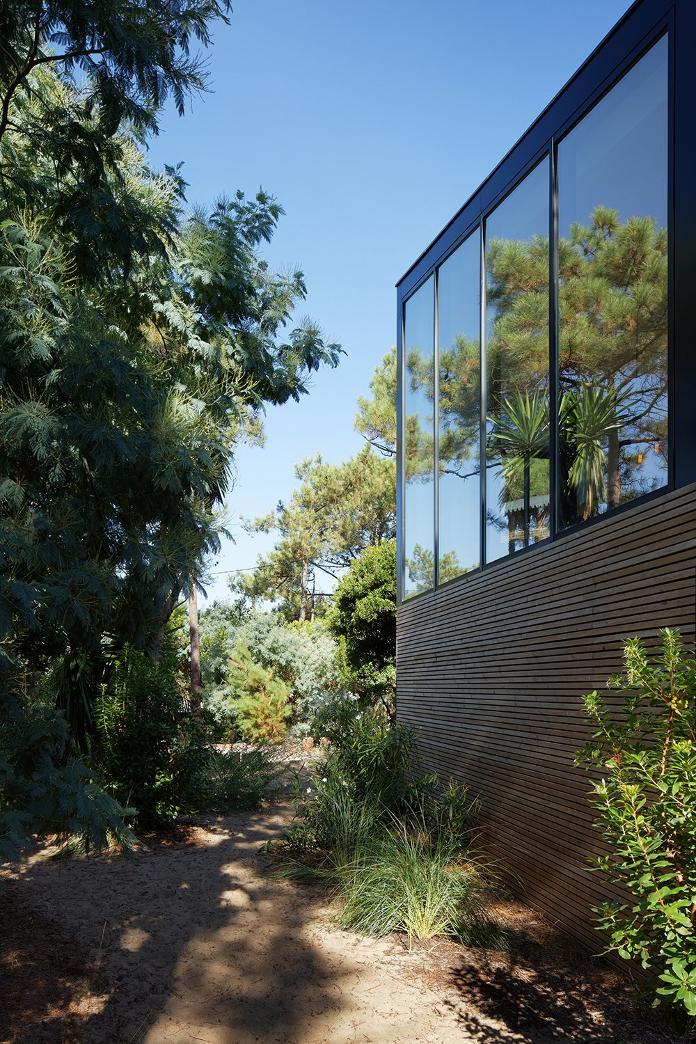 Minimal materials allow the dwelling to blend kindly into the surroundings, while large amounts of glazing increase the connection between built form and nature.   Photo 5 of 13 in Multiple Modern Cabins Make Up This French Holiday Home