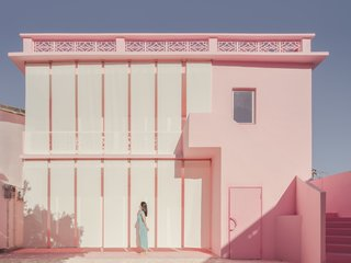 Curtains wrap Her House like a veil, creating a feminine solution for a new facade.