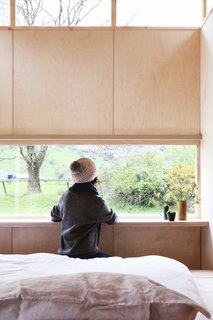 A built in ledge set directly at the window provides a desk surface.