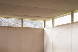 Continuous windows draw daylight deep into the space, while providing views of the distant landscape and sky beyond.