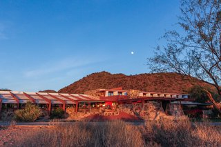 Today, Talesin West continues to be the headquarters of the Frank Lloyd Wright Foundation and School of Architecture. Rich red hues and earthy sandy tones create a close relationship between the buildings and the landscape.