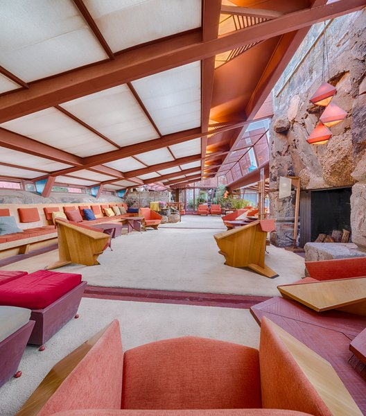 A stone heart anchors the grand space.  Custom Wright designed furnishings, titled Taliesin Wright Chairs, purposefully designed for the human scale, provide a variety of seating options, covered in rich velvet textiles.